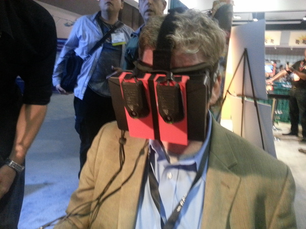 Man with two cameras taped to an Oculus Rift.