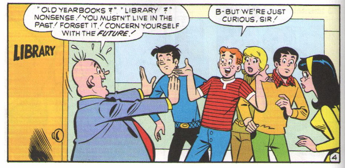 Mr Weatherbee in front of the Riverdale High library