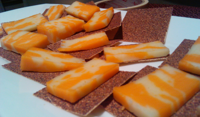Photograph of hors d'oeuvres: slices of cheese on sandpaper