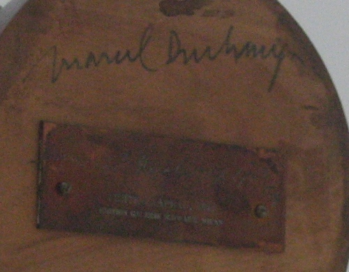 Photograph of Duchamp's signature on the bottom of the hat rack